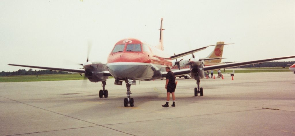 Skyhawk Heavy standing next to Saab 340 at Gulfport.
